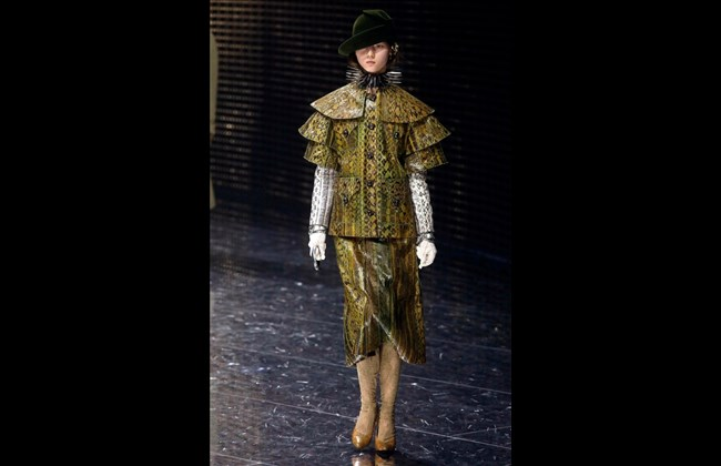 Gucci puts on eclectic masquerade catwalk